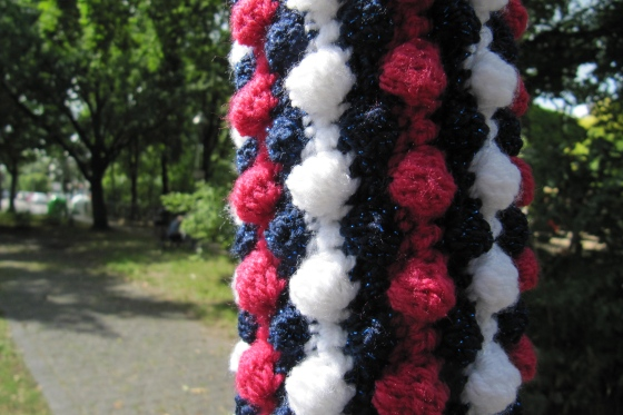 street sign yarn bombing